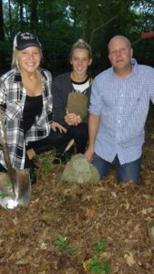 Danielle Dionne (left), Kassie Sandra, and Jason Dionne. Kassie holding a recovered foot stone